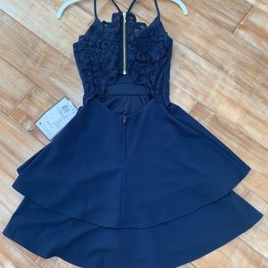 Super cute open back short dress